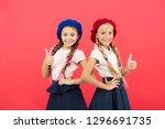 schoolgirls wear formal uniform ... | Shutterstock . vector #1296691735
