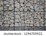 stone gabion wall | Shutterstock . vector #1296705922