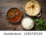 goat or lamb mutton curry with... | Shutterstock . vector #1296739135