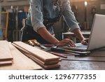 carpenter working with... | Shutterstock . vector #1296777355