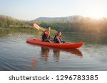 father and daughter rowing boat ... | Shutterstock . vector #1296783385