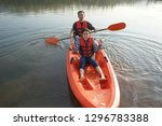father and daughter rowing boat ... | Shutterstock . vector #1296783388
