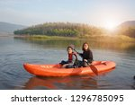mother and daughter rowing boat ... | Shutterstock . vector #1296785095