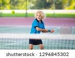 child playing tennis on indoor... | Shutterstock . vector #1296845302