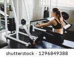 beautiful athlete exercising... | Shutterstock . vector #1296849388