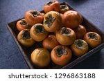 fresh crisp persimmon  | Shutterstock . vector #1296863188