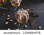 homemade muffins with chocolate ... | Shutterstock . vector #1296864478