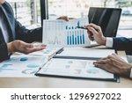 finance manager meeting... | Shutterstock . vector #1296927022