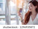 women crazy shopaholic holding...   Shutterstock . vector #1296935872