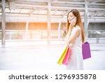 women crazy shopaholic holding...   Shutterstock . vector #1296935878