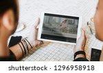 couple watching movie online on ...   Shutterstock . vector #1296958918