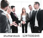 business handshake in a modern... | Shutterstock . vector #1297030345