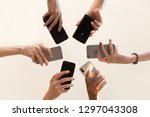 low angle shot of women hands... | Shutterstock . vector #1297043308