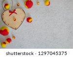 wooden heart and fluffy pom... | Shutterstock . vector #1297045375