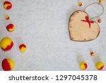 wooden heart and fluffy pom... | Shutterstock . vector #1297045378