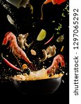 flying  soup tom yam with... | Shutterstock . vector #1297065292