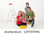 Happy people family preparing to paint their home - stock photo