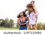 happy african family enjoying... | Shutterstock . vector #1297115485