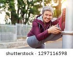smiling retired woman listening ... | Shutterstock . vector #1297116598