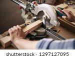 closeup of a carpenter using a... | Shutterstock . vector #1297127095