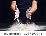 Small photo of Chef shakes flour. The hands of men loosen the flour for making pizza, pie. Homemade culinary traditional prepare. Hand of chef with flour close up.
