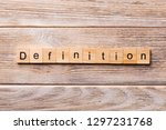 Small photo of Definition word written on wood block. Definition text on wooden table for your desing, concept.
