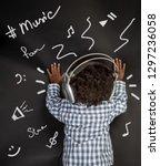 rear view of a little music... | Shutterstock . vector #1297236058