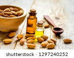 spa with almond oil in organic... | Shutterstock . vector #1297240252