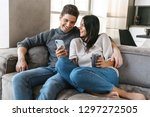 happy young couple sitting on a ... | Shutterstock . vector #1297272505