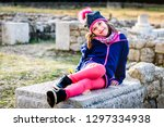 girl is sitting on remains of... | Shutterstock . vector #1297334938