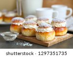 Small photo of Homemade semla or vastlakukkel (in Estonia) is a traditional sweet roll with whipped cream made in Scandinavic and Baltic countries for Shrove Tuesday or related days