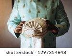 hindu groom holds his wedding... | Shutterstock . vector #1297354648