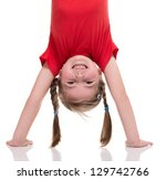 little girl standing on her... | Shutterstock . vector #129742766