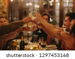 group of people toasting drinks ... | Shutterstock . vector #1297453168