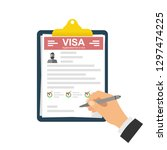 clipboard with visa application.... | Shutterstock .eps vector #1297474225