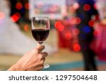 hands clinking wine glasses a... | Shutterstock . vector #1297504648
