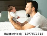 father and newborn baby closeup ... | Shutterstock . vector #1297511818