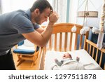 tired father with upset baby... | Shutterstock . vector #1297511878