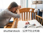 tired mother with upset baby... | Shutterstock . vector #1297511938