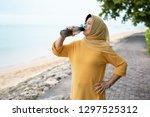 senior muslim woman drink water ... | Shutterstock . vector #1297525312