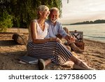 loving senior couple enjoying a ... | Shutterstock . vector #1297586005