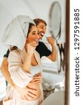 pregnant woman and her husband... | Shutterstock . vector #1297591885