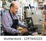 smiling mature man working in... | Shutterstock . vector #1297642222