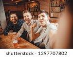 cheerful friends make selfie... | Shutterstock . vector #1297707802