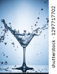splashing water on blue... | Shutterstock . vector #1297717702