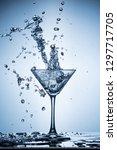 splashing water on blue... | Shutterstock . vector #1297717705