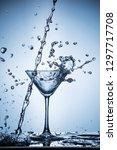 splashing water on blue... | Shutterstock . vector #1297717708
