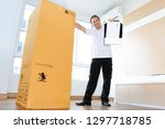 a man in an empty room shows a... | Shutterstock . vector #1297718785
