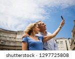tourist couple on vacation... | Shutterstock . vector #1297725808