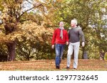father and adult son laughing... | Shutterstock . vector #1297732645